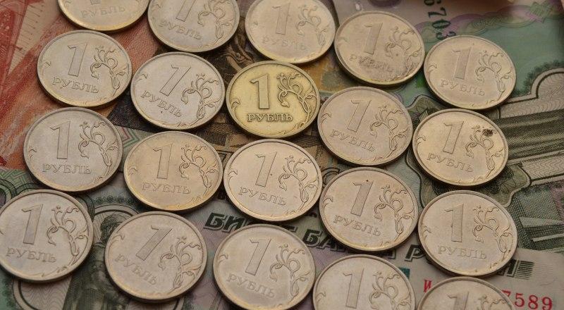 Усилия Центробанка смягчили падение рубля относительно снижения нефтяных цен. Фото Александра КАДНИКОВА.