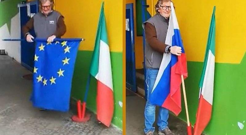 Житель коммуны Оменья в регионе Пьемонт Федерико Кейн сворачивает флаг Евросоюза, а вместо него устанавливает флаг России.